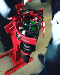 Coil spring compressing service