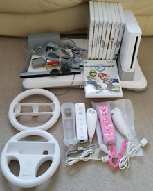 Wii + 9 games inc mario kart + wii fit board