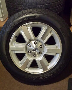 Ford F150 premium rims and tires. Barely used. PRICE REDUCED!!