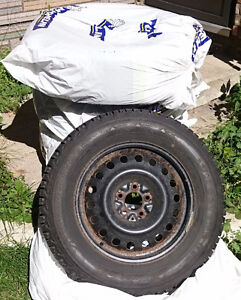 Firestone Winter Tires and Rims set, low KMs on tires! London Ontario image 1