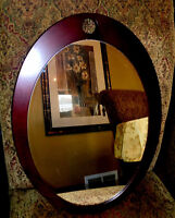 Oval wooden accent mirror , 20 inches by 15 inches