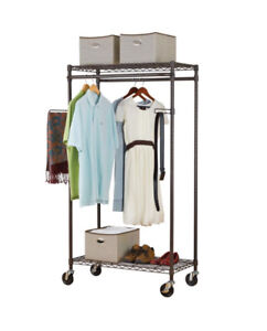 Clothing Rack on wheels with shelves and arms