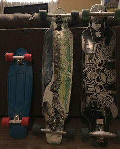 2 sector 9 longboards and a penny board