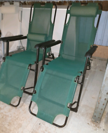 A new stulish pair of green fully reclining sun loungers.