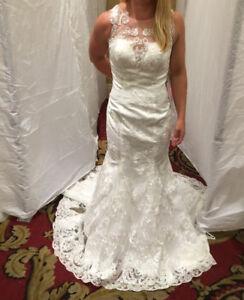 Brand new wedding gown, unaltered!