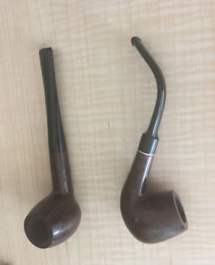 2 vtg unused smoking pipes .They were only ousted for display
