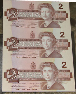 Sheet of three 1986 two dollar bank notes