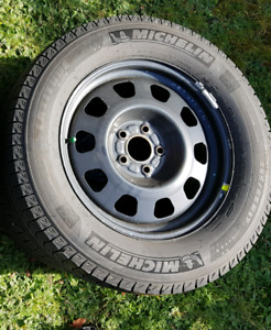 (4) 235/65/17 Michelin x ice winter tires on rims used 1 year