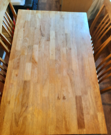 Wooden dining table with 4 chairs