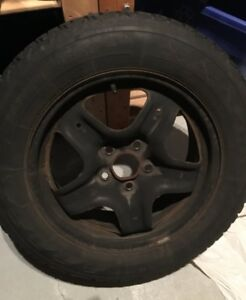 "4 Firestone P215/65R17 snow tires (matched to 18"" wheels)"