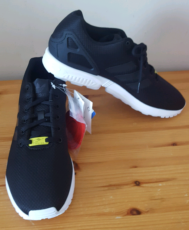 separation shoes 1a3b5 7cf09 BNWT Black Adidas ZX Flux size 12 (mens)