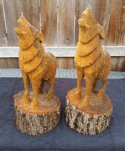 2 Chainsaw carved wolves
