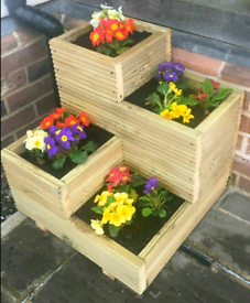 Planters in natural treated decking wood