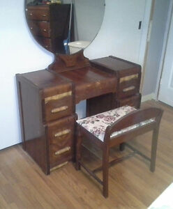 Antique Vanity with round mirror and chair.