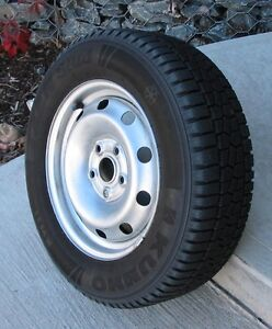 For Sale-  A set of four Audi steel wheels, with snow tires