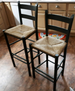2 Wooden stools or chairs with woven seats-$25