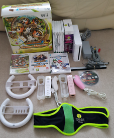 Wii + 10 games inc mario kart, wii sports & family trainer mat
