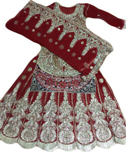 Wedding dress: Pakistani/Indian bridal lehenga.