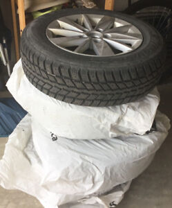 FOUR SNOW TIRES WITH MAG WHEELS