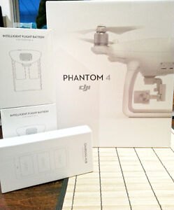 NEW DRONE DJI PHANTOM 4 with 2 Batteries and charger Hub