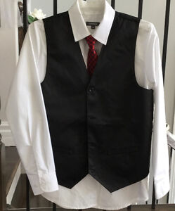 White dress shirt, vest and red tie
