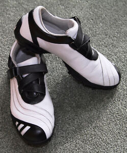 Gently used Lady Black and White Leather Adidas Z-Traction Shoes