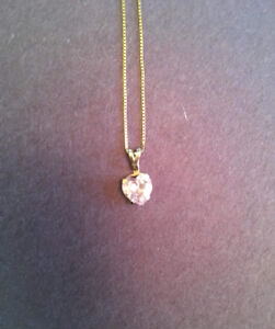 Gold necklace with pink heart gem