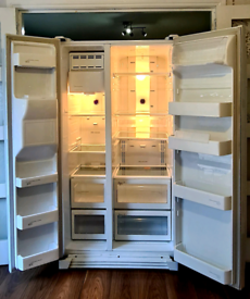Samsung American Fridge Freezer with Water/ice Dispenser.