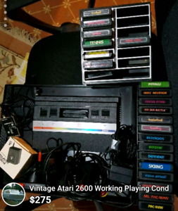 Atari 2600 with 20 + Games + Controllers and More.