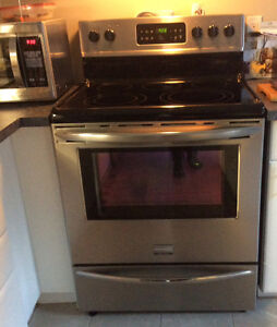 Moving sale-Stainless Steel Frigidaire Glass top Range