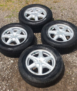 "Oldsmobile Aluminum 15"" Rims and tires"