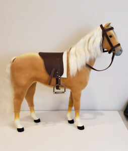 Genuine American girl plush horse with bridle and saddle.