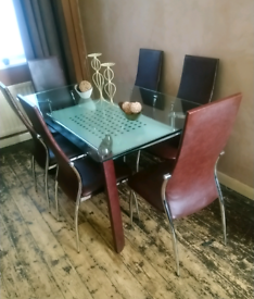 WOW.... LOOK AT THIS. Ex store display dining table and chairs.