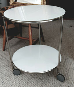 Table, round 2 tier, white glass and metal, wheels $35