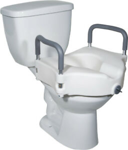 Raised Toilet Seat with locking arms New in Box . $55.00. from D