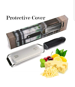 NEW. Stainless steel grater