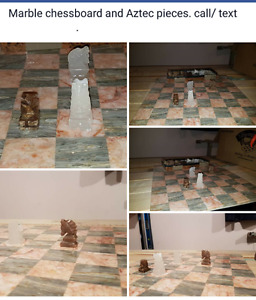 Marble chessboard and Aztec pieces .