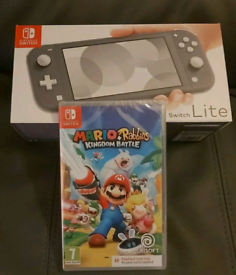 Nintendo Switch lite + 1 Mario game and charger boxed