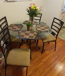 Round glass kitchen table with four chairs