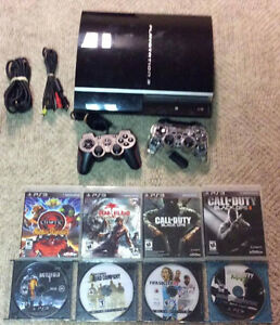 160GB Playstation 3 with 2  Controllers and 8 Games!