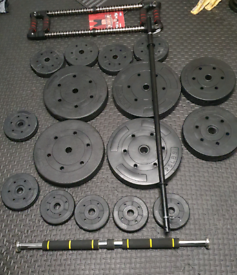 Weights plates, barbell,pull up bar and chest expander (gym equipment)