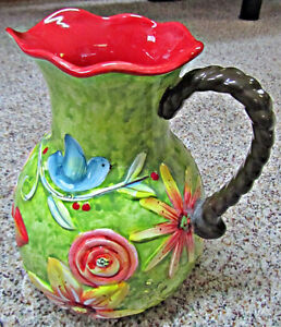 Hand painted/embossed ceramic pitcher