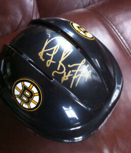 Mini  Bruins helmet, signed by  Ray Bourque