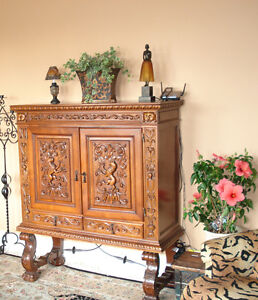 Spanish cabinet with Rampant Lion carving and iron stretchers
