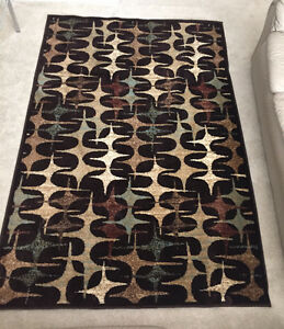 Area Rug and Glass Table