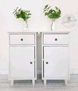 Two white side tables