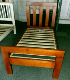 A new stylish dark wood single bed frame.