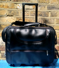 Suit case. Leather. Hand luggage. Business