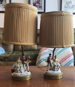 2 brass lamps with porcelain figurines on the bases