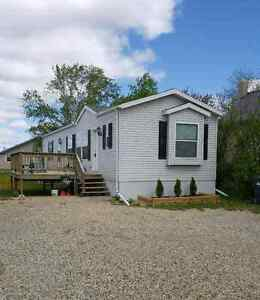 For Sale in  Weyburn/Owned Lot